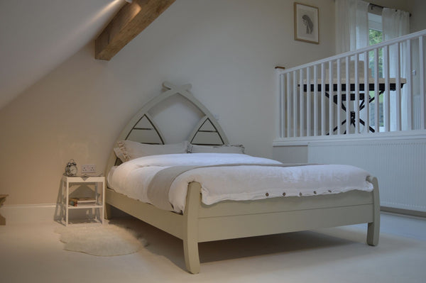 Handmade wooden bed with curved arched planked headboard