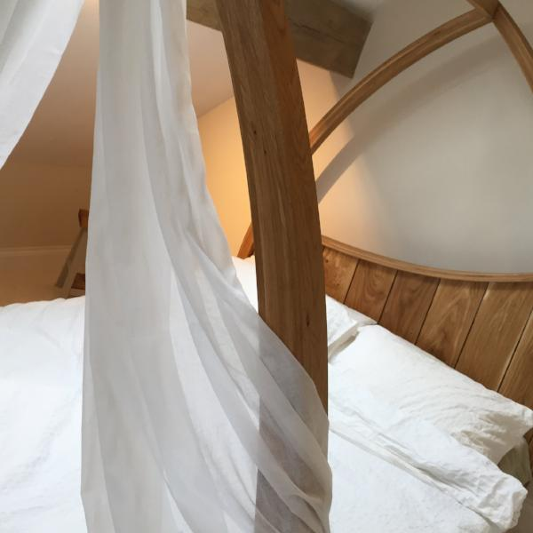 Oak Four Poster - Curved, minimal , modern design with drapes.