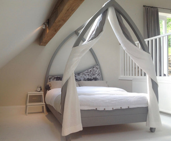 Modern plain curved four poster bed painted grey