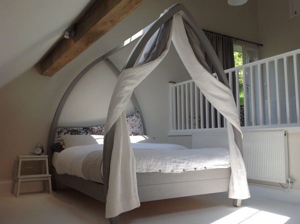 Modern curved four poster bed painted grey