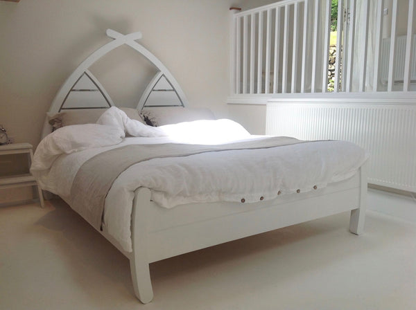 Double bed with curved arched planked wooden headboard