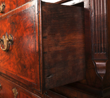 detail of a burr walnut antique chest on chest