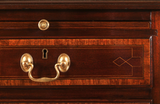detail of antique mahogany and satinwood chest of drawers