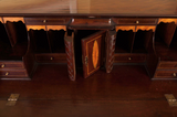 detail of antique mahogany bureau showing fitted interior