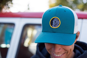 """Diver"" Patch on a Teal and Cream Curved Bill Trucker Hat"
