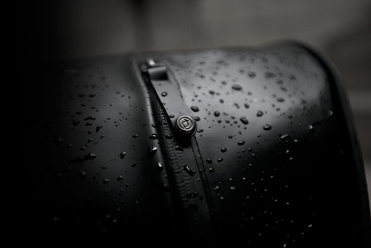 water-repellent messenger bag