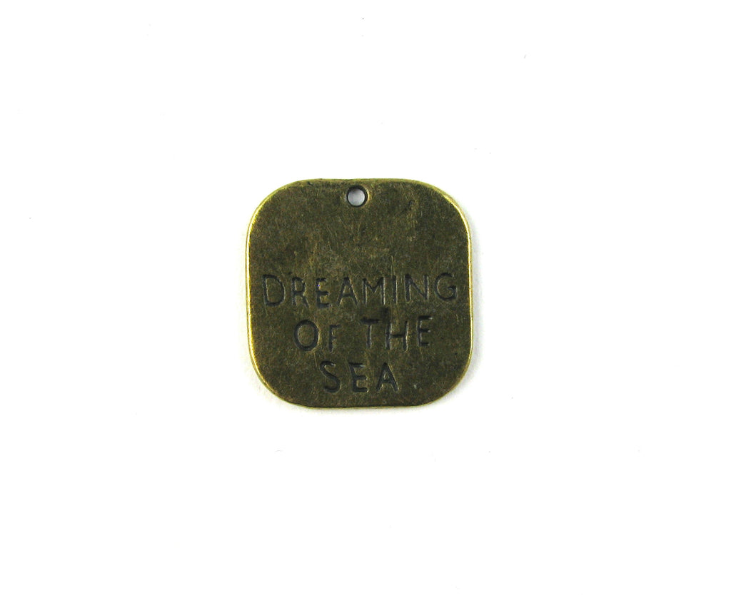 """Dreaming of the Sea"" Antique Brass Charm"
