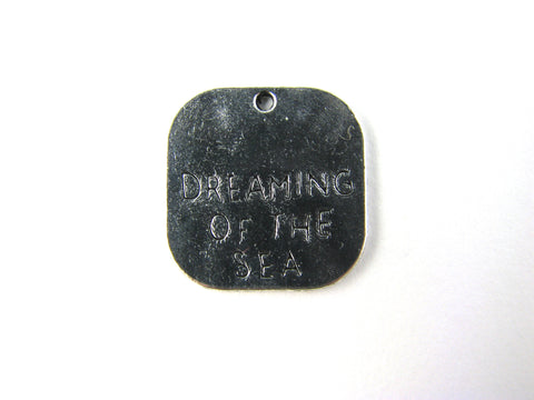 """Dreaming of the Sea"" Silver Toned Charm"