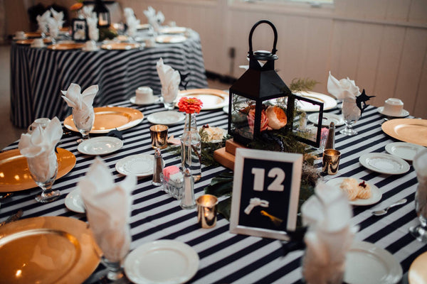 little miss lovely floral design // nautical gold navy wedding lantern centerpieces // ocean city maryland wedding florist // the hursts photography