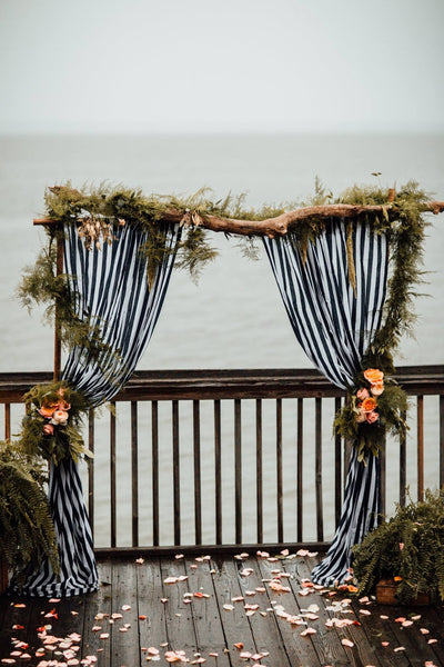 little miss lovely floral design // nautical driftwood wedding archway // ocean city maryland wedding florist // the hursts photography