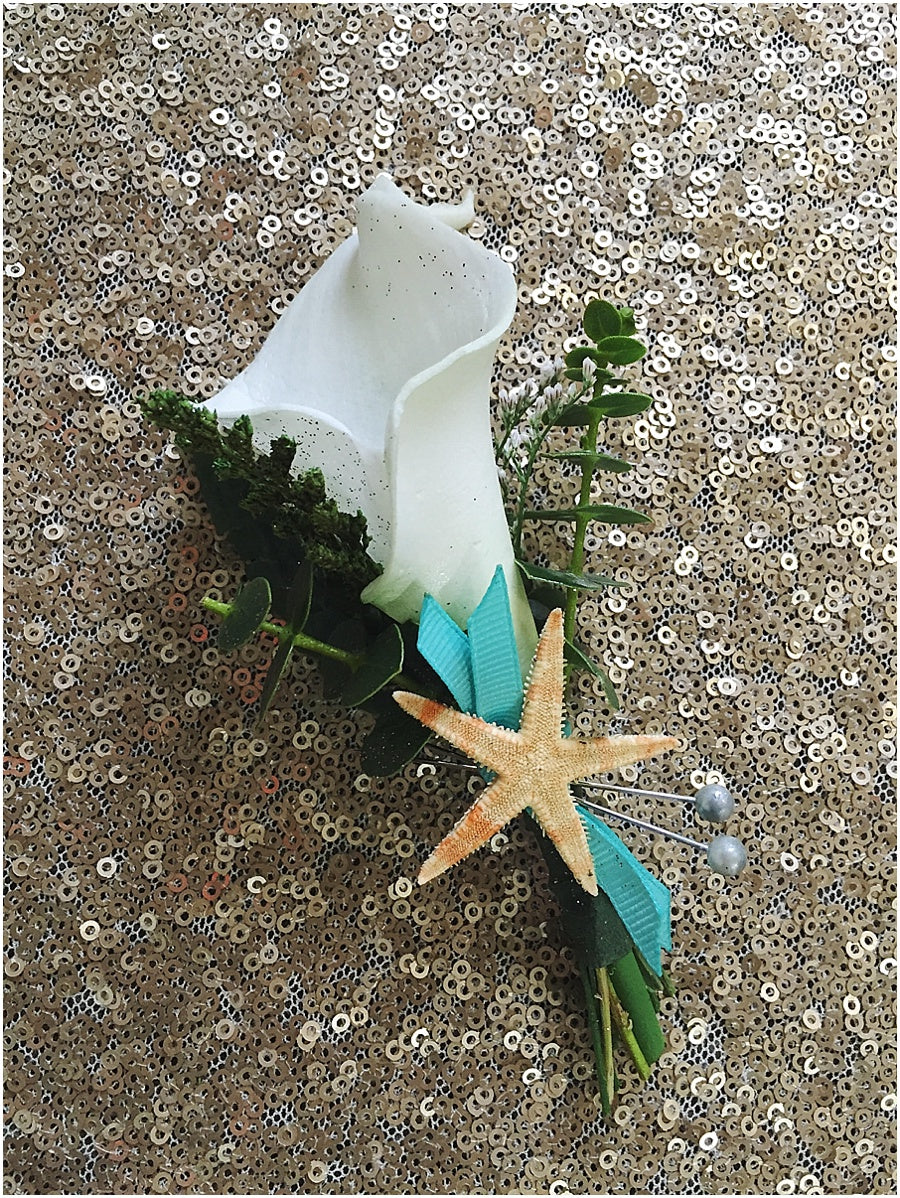little miss lovely floral design // disney castaway cay cruise wedding flowers // calla lily boutonniere with starfish