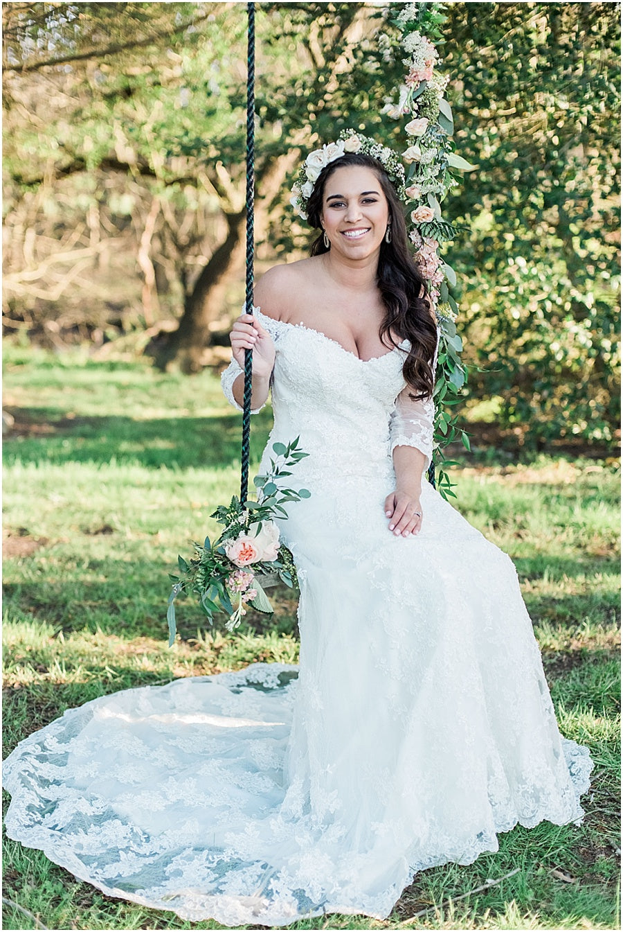 leah adkins photography // little miss lovely floral design // bride on swing decorated with flowers