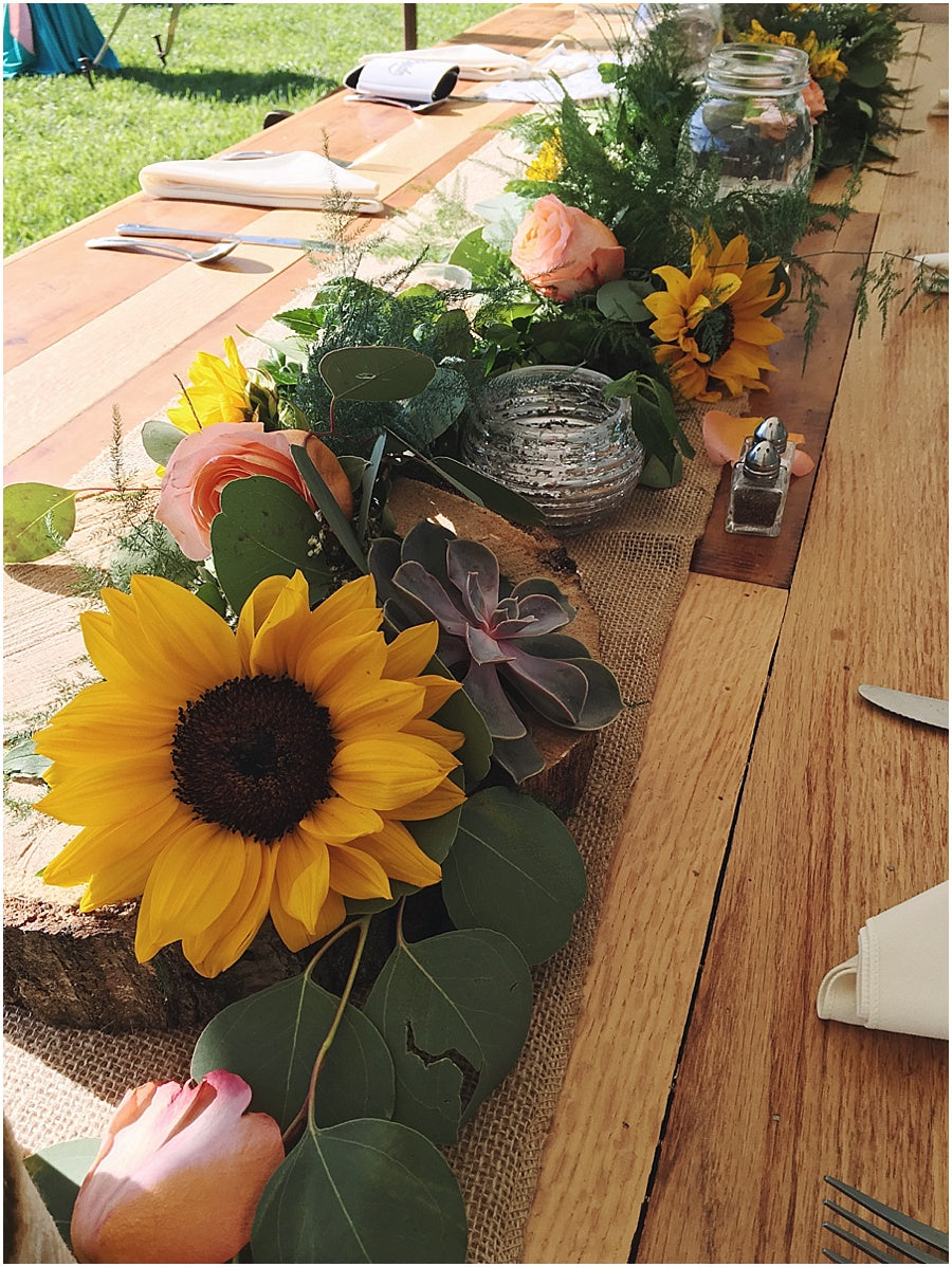 little miss lovely floral design // garland head table arrangement with sunflowers