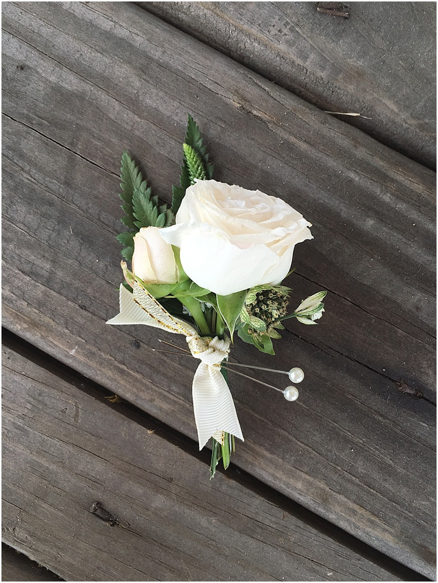 little miss lovely floral design // indian river life saving station wedding // groom boutonniere