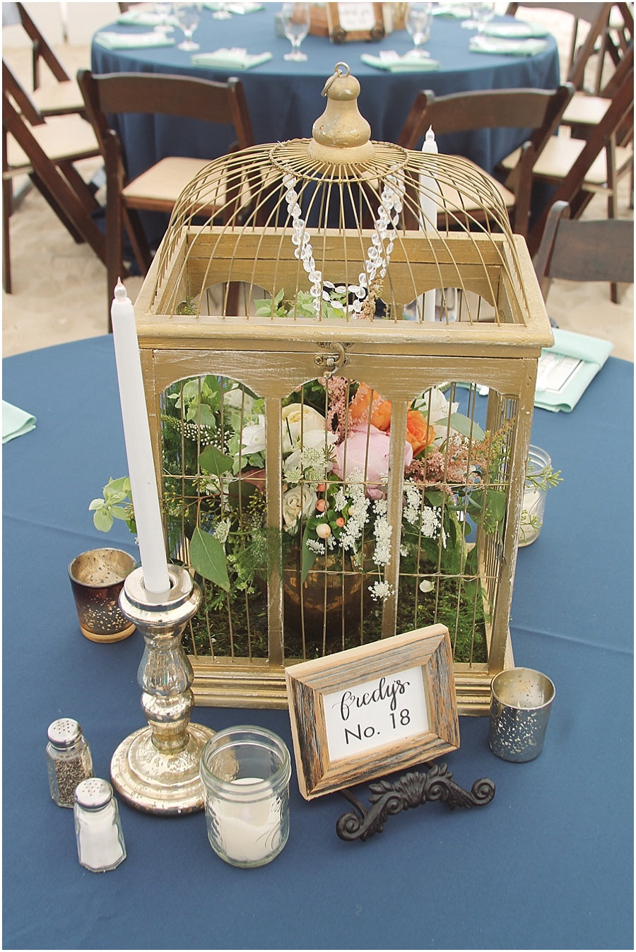 little miss lovely floral design // indian river life saving station wedding // gold birdcage floral centerpiece