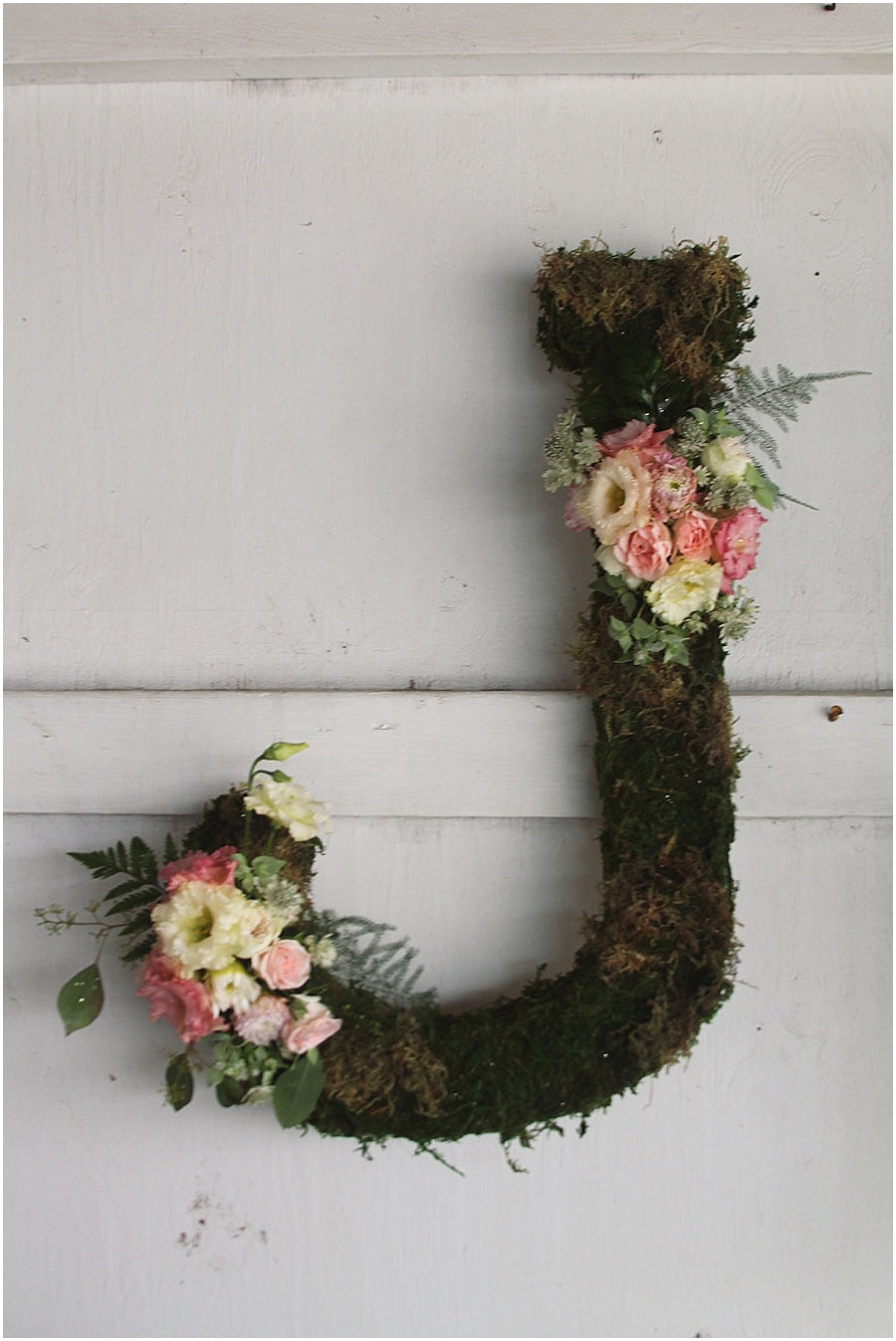 little miss lovely floral design // rehoboth beach de wedding // moss covered letters with floral accents