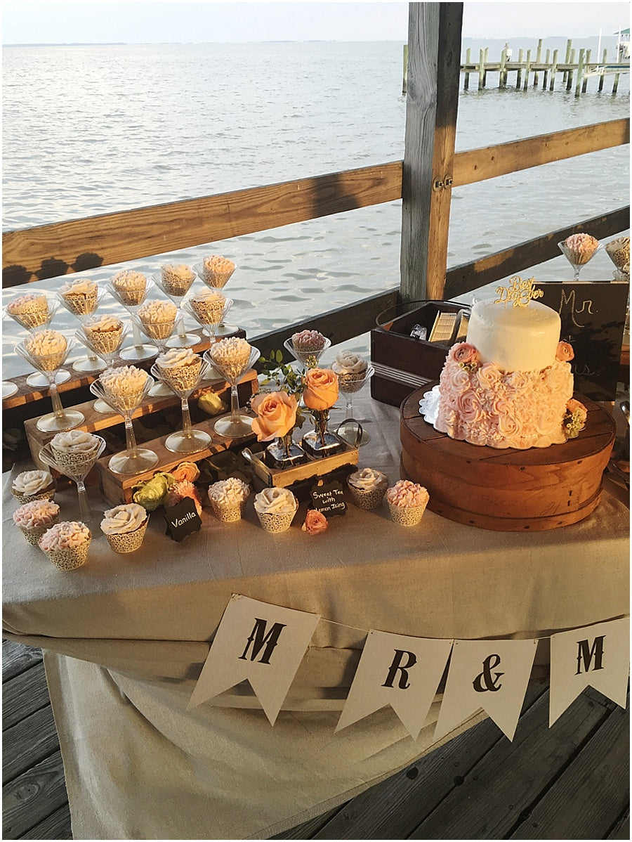 little miss lovely floral design // public landing snow hill maryland wedding // cake table cupcakes in glasses