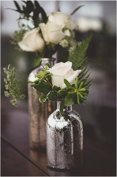 little miss lovely floral design // rental items // silver mercury glass bottles