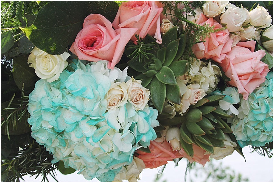 little miss lovely floral design // green hill country club wedding // teal hydrangea coral charm peony succulent driftwood archway