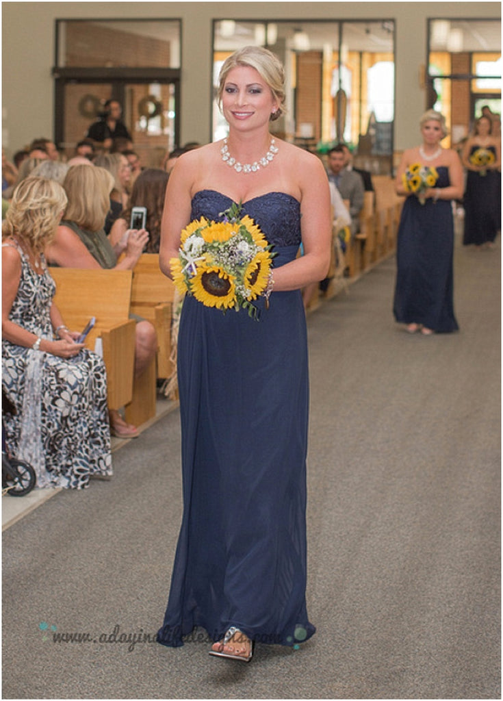 little miss lovely floral design // sunflower starfish sand dollar bouquets // seacrets wedding // navy white yellow wedding