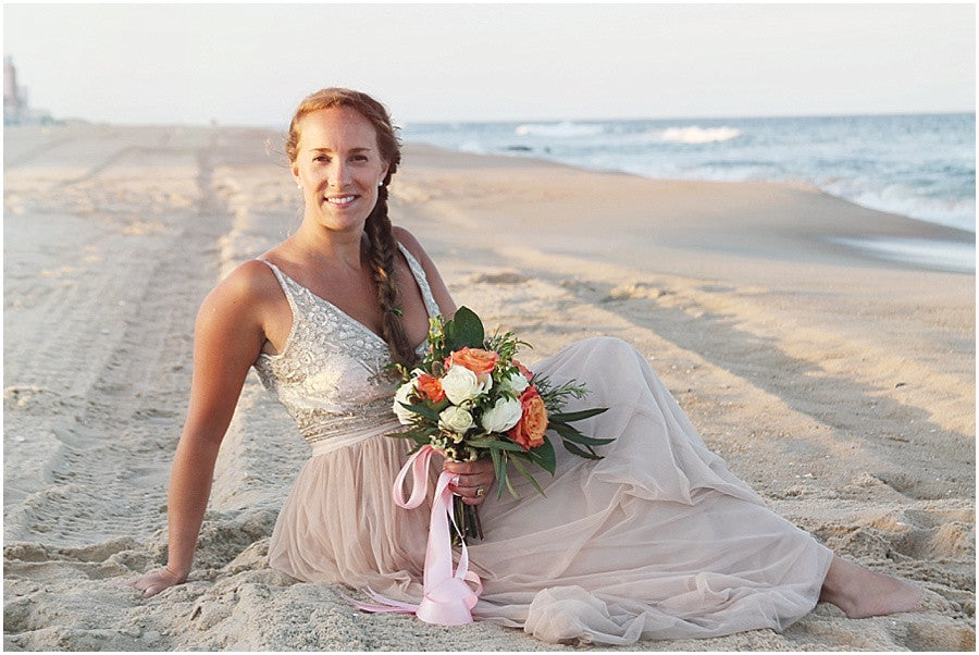 little miss lovely floral design // ocean city wedding florist // coral blush white wedding with circle archway