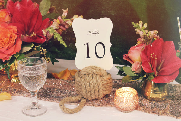 little miss lovely floral design // event rentals // rental items // nautical jute rope ball table numbers
