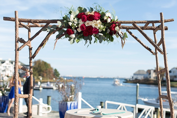 little miss lovely floral design // rustic pine archway // ocean city maryland wedding rentals