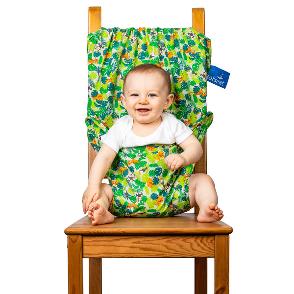Our new Jungle Friends totseat comes on a soft ecru fabric featuring lions, monkeys and toucans on a jungle background. The totseat is ideal for your bouncy baby or to be given as a gift. Recommended for babies and toddlers aged 6-30 months, this lightweight and versatile chair harness anchors your child safely and comfortably in almost any dining chair you can find. totseat - the original portable travel high chair