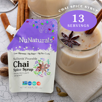 6.6 oz. NuNaturals Chai Spice Pourable Stevia Syrup with glass mug of chai with spices and cinnamon