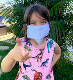 7 year old little girl wearing De Soto Skin Cooler face mask made for children, kids, ppe