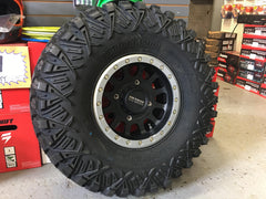 Pro Armor Crawler XG 32-10-14 on Method 401 Matte Black w/ silver rings