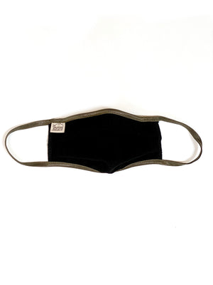 Black gauze face mask against white background