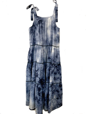 Maxi dress with tie shoulder straps in white and dark blue tie dye aka moon wash against an all white background. Dark blue velvet trim along each tier of the dress.