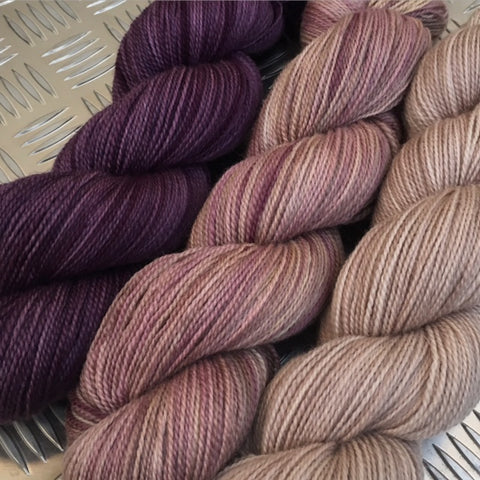 Reading The Tealeaves, The Faded Rose, The Merry Widow L to R Stein Fine Wool® 4ply
