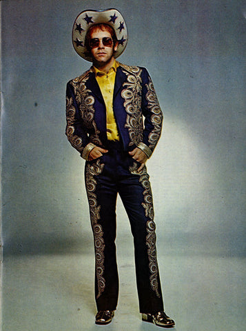 Elton John wearing Nudie Cohn suit and Stars Cowboy Hat