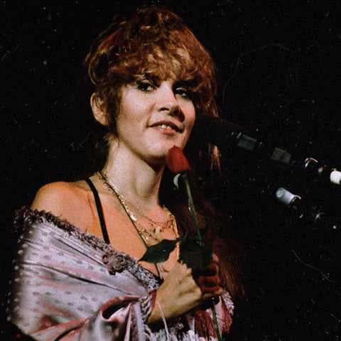 Stevie Nicks Holding Red Rose on stage