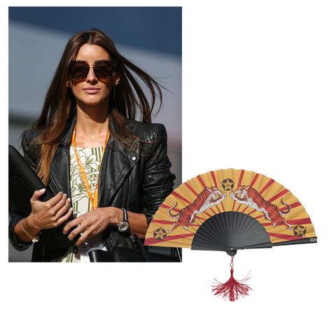Formula One Girlfriend wears leather jacket and Khu Khu tiger tiger fan added to image