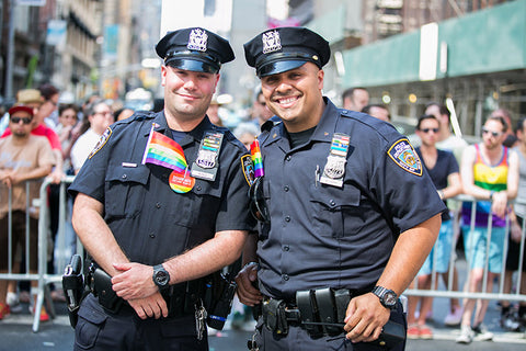Police supporting LGBT by wearing flags at NYC PRIDE