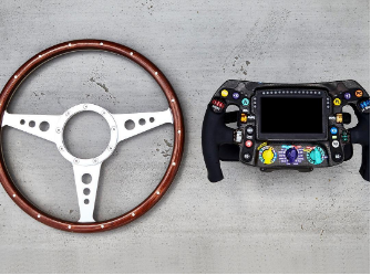 Formula One steering wheel the original leather style compared to the digital box of 2019