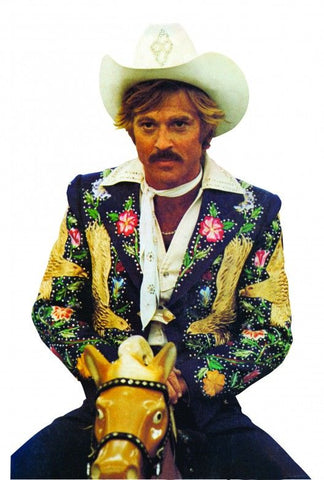 Robert Redford in Electric Cowboy wearing Nudie Cohn suit on fairground horse