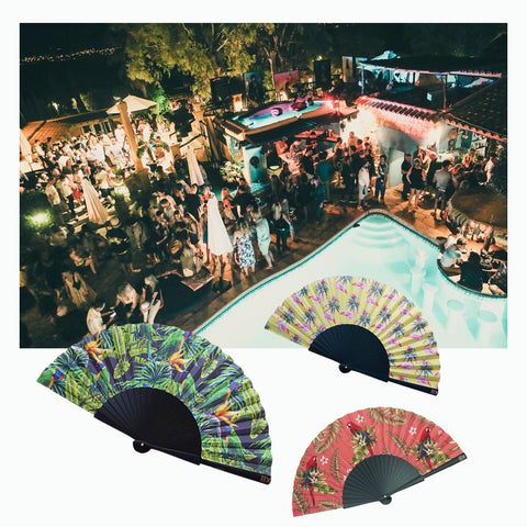 Three Tropicana Khu Khu hand-fans on top of an image of Pike´s Boutique Hotel in Ibiza