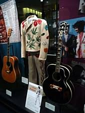 Gram Parsons Nudie Cohn Suit in Museum surrounded by his guitars
