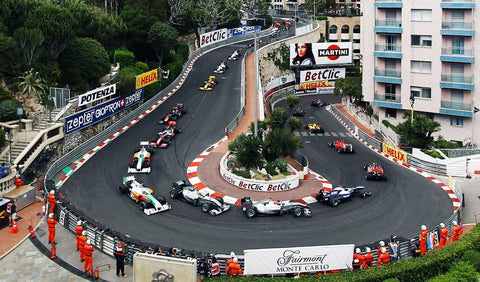 Monaco formula one sharpest bend in the track with lots of cars going round the corner