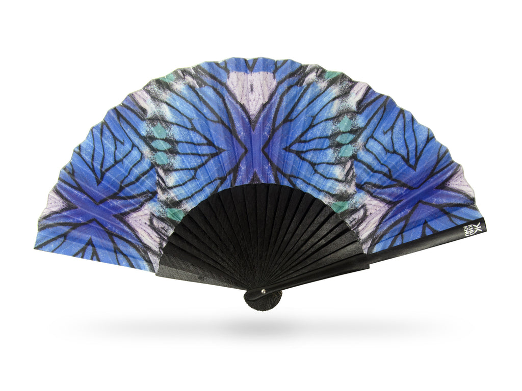 Khu Khu Blue Lyca Beautiful Butterfly print hand-fan with geometric symmetrical close up of butterfly wing in blue, turquoise and black with black wooden sticks.