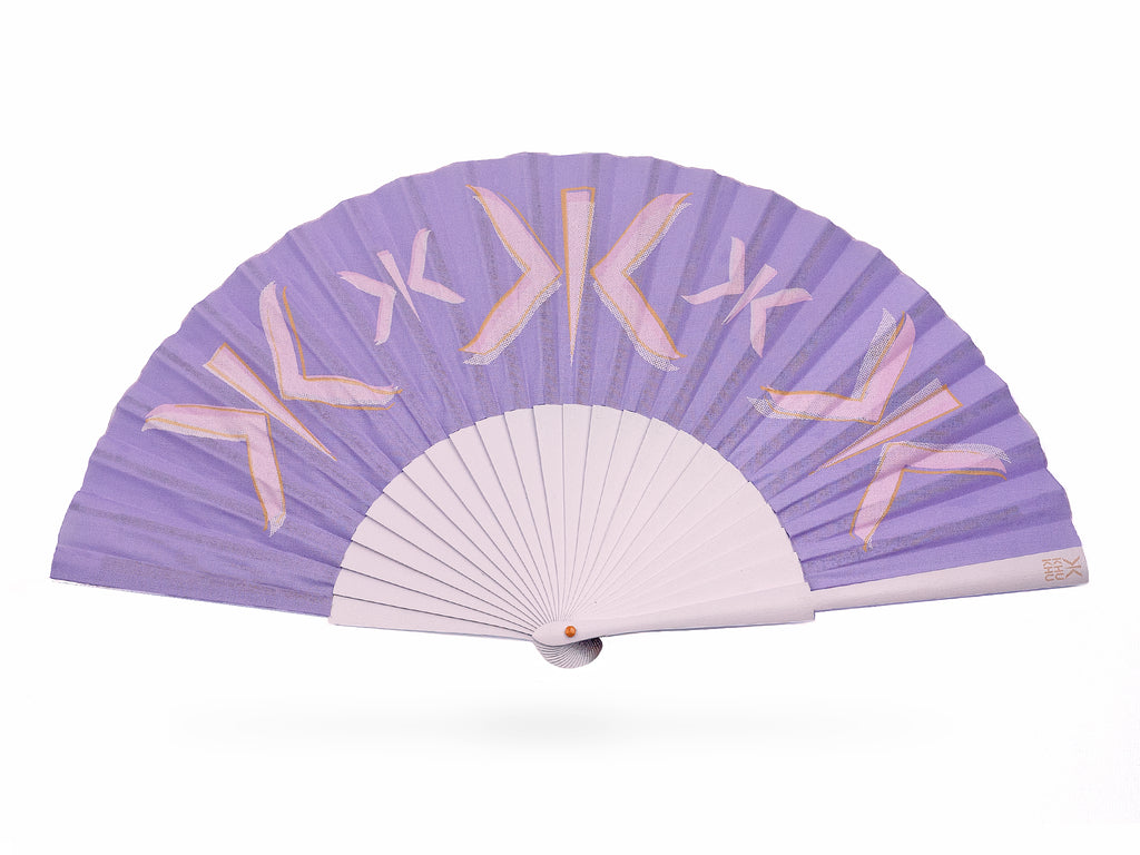 Khu Khu Lilac Letter pastel Hand-Fan with layered screen-prints of the Khu Khu logo in lilac, pink and burnt orange. Cotton fabric and lilac sticks with orange logo/rivet and lilac rim.