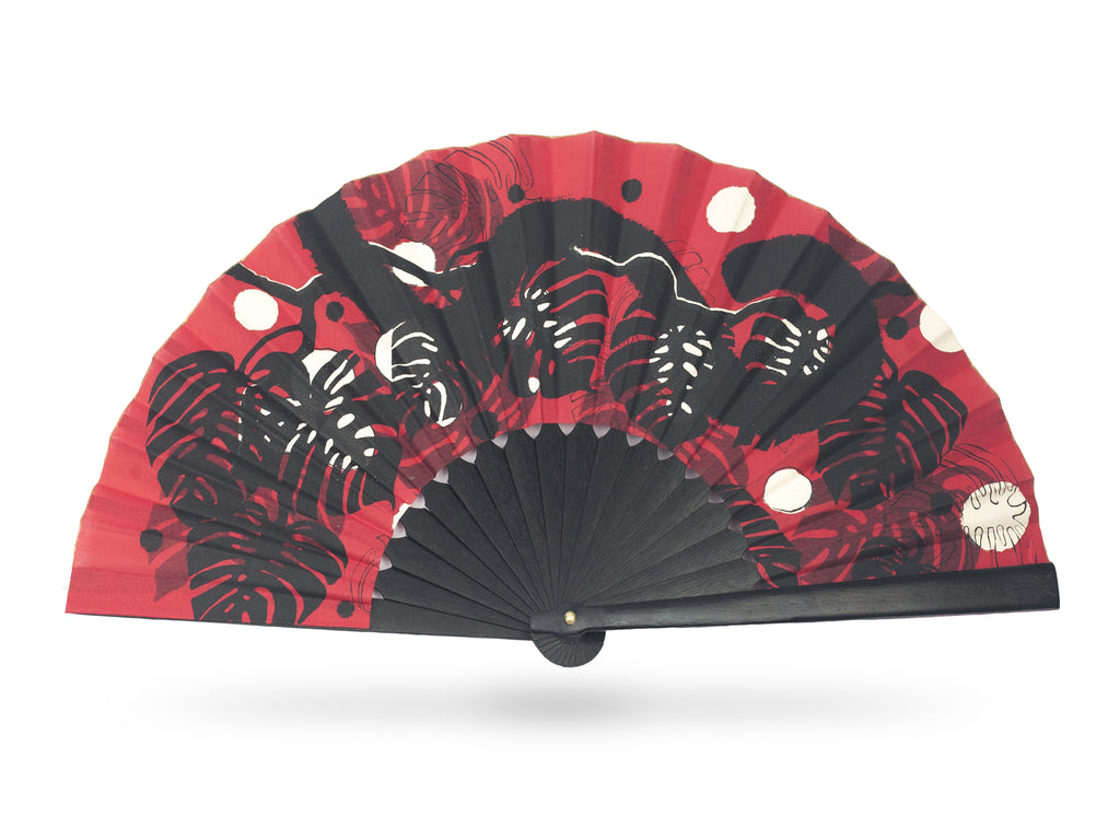 Khu Khu Asian Panther luxury hand-fan. Hand screen printed panther tail swishes through tropical red black and white jungle foliage