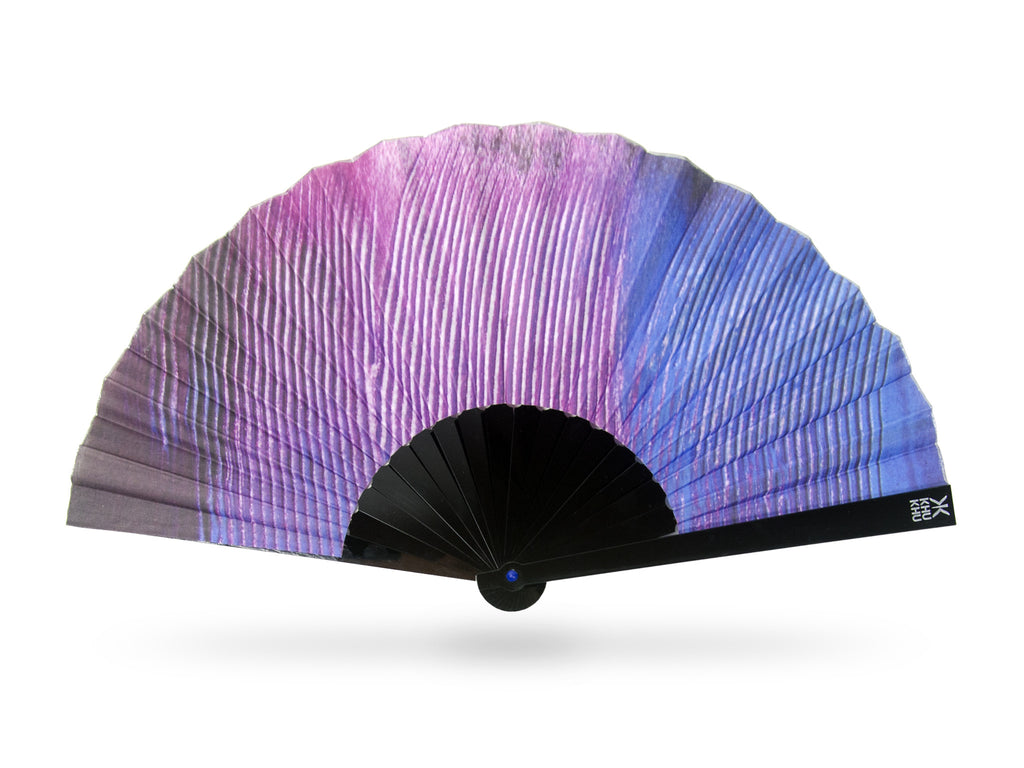 Khu Khu Premium Cotinga Tropical Bird Wing Print Hand-Fan in purple and blue tones. Painted and then printed onto high grade cotton with swiss acrylic bespoke shape sticks. Blue rivet and silver rim. Engraved logo.