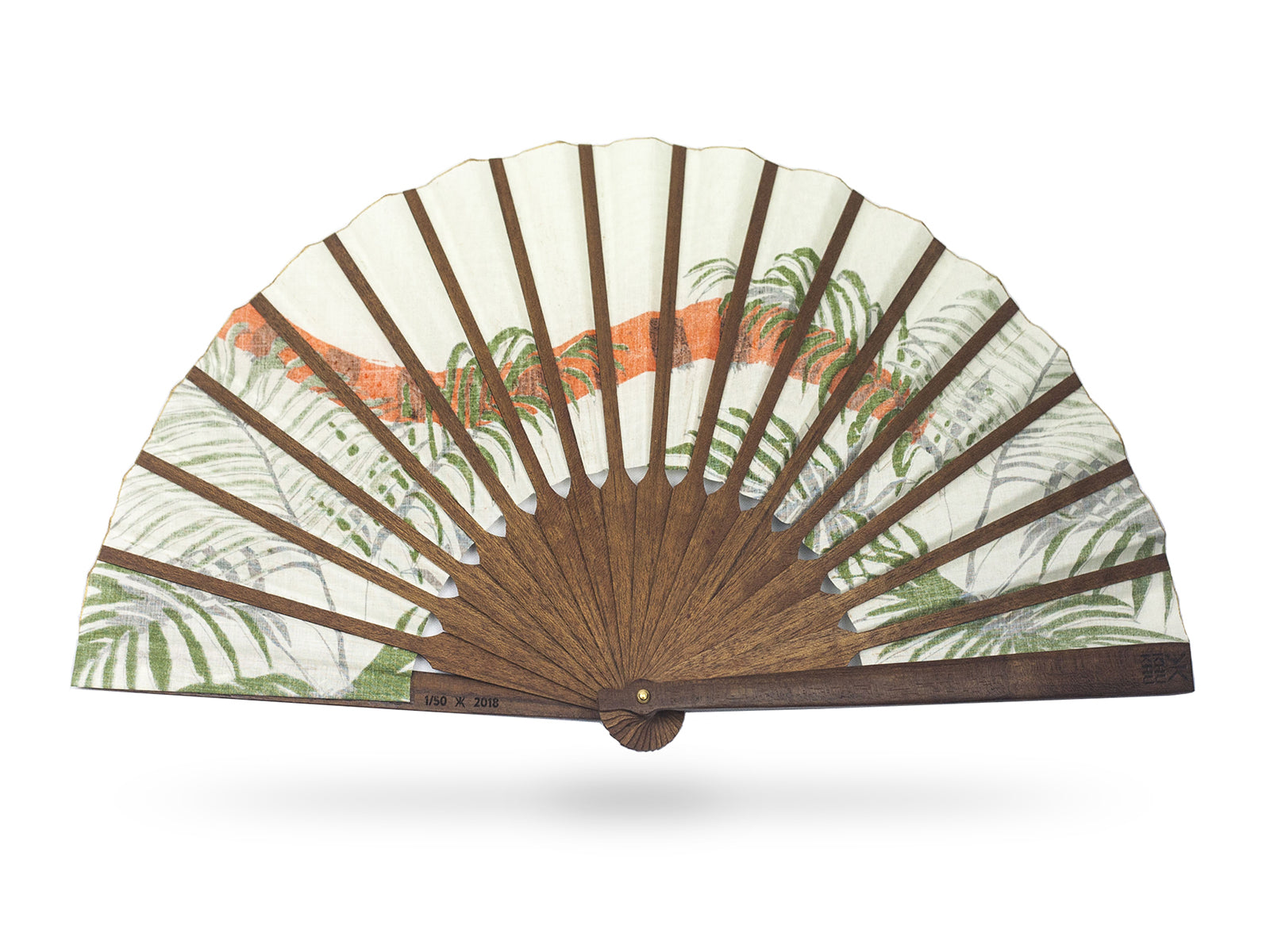 View of the back of Khu Khu Indian Tiger luxury hand-fan. Hand screen printed orange and black Indian Tiger tail swishes through tropical green fern leaves with cream background mounted with premium cherry wood in exclusive Khu Khu shape with polished brass rivets. .
