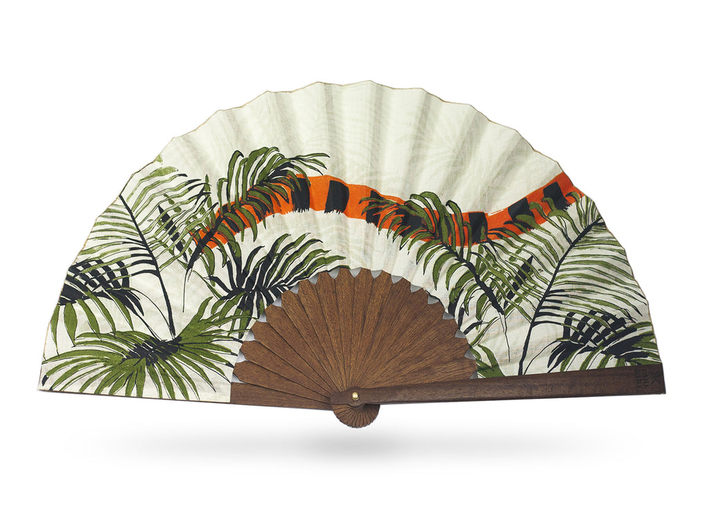 Khu Khu Indian Tiger luxury hand-fan. Hand screen printed orange and black Indian Tiger tail swishes through tropical green fern leaves with cream background mounted with premium cherry wood in exclusive Khu Khu shape with polished brass rivets. .