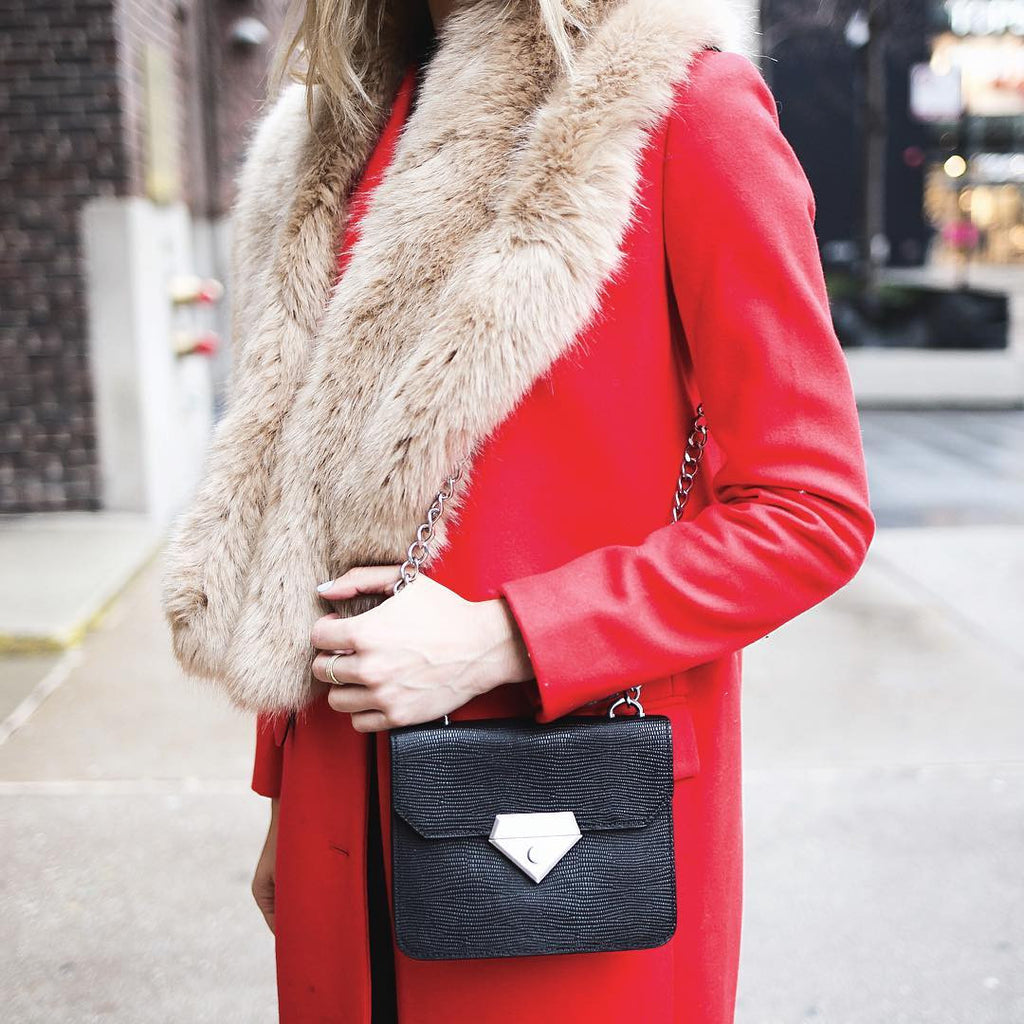 Sportsanista wearing the Linea Pelle Bowery Shoulder Bag in Black Lizard